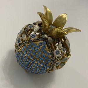 Stone encrusted pomegranate
